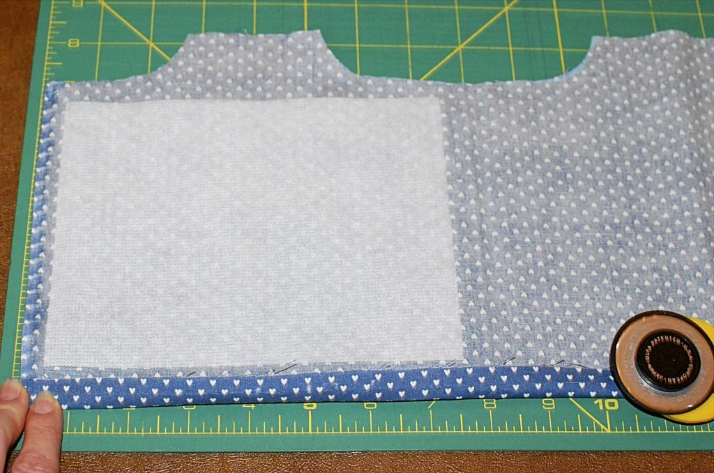 Bottom Edge Folded Up and Interfacing Placed on Fabric Back Side